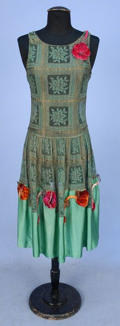 LACE EVENING DRESS with FLORAL APPLIQUE, 1920's. Sleeveless green and gold metallic lace having floral blocks, lower skirt of jade green silk charmeuse appliqued with velvet poppies. Front
