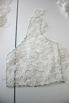 Adding A Lace Overlay To A Strapless Wedding Gown:Thread tracing and applique…