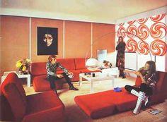 Feeling groovy in the 1970s in Germany. Stupid dangling lamp, hideous wallpaper....