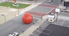 Public art installation RedBall in Toledo, Ohio accidentally got knocked loose by strong storm winds and is causing havoc in the city.