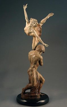 """""""Bird in the Hand"""" is a romantic bronze sculpture by visionary master sculptor Martin Eichinger. As she balances free in flight with her eyes closed symbolizing total trust between them. They have complete faith in one another."""