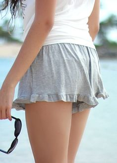 We're completely in love with these crazy soft, crazy comfy ruffle shorts! Features heather gray knit and elastic waistband for a stretchy, comfortable fit. Shorts sit on the high hips and are flowy. Super cute to style with your fave graphic tee or crop top or wear over a bikini at the beach!  ...