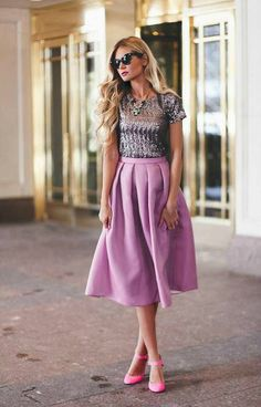 Sparkly top, lilac skirt, and pink heels finished with a statement necklace.