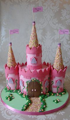 im thinking this style of cake for ellie, but decorated with candy. Have the main frame pink lemonade cake, the towers out of rice kripsy treats, with a gumdrop path. The tower roof will be an ice cream cone covered in frosting and rolled in sprinkles. Other candy: twizzlers, lots of pink candy