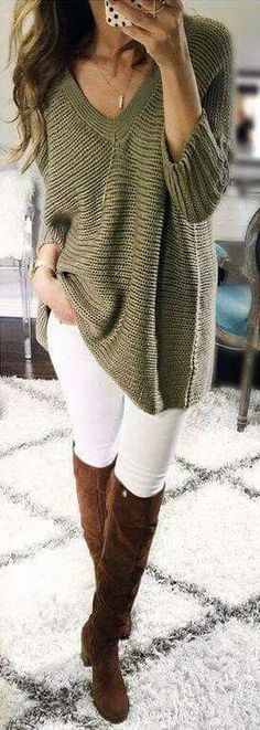 Olive sweater over white jeans with brown OTK boots.