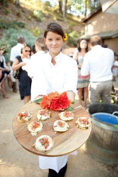 love it all. the flower in the wait staff's hair. passing h'orderves on barrel lids at a vineyard wedding. perfect.