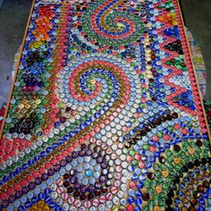 A friend of mine made this beer cap table from a 30 year old table handmade by her dad....and lots of beer caps! Too awesome!