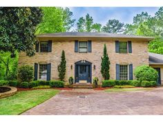 Let this beautiful, winding, tree-lined street lead you to your next home. This custom one-of-a-kind home is right in the heart of Dunwoody. Secluded lot offers a beautifully lush green backyard that overlooks a sparking pool
