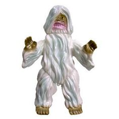 "The classicly wild and wooly Ultra Creature rears his hairy head again! found at super7store.com    Woo is Cast in white vinyl with light blue, gold, and pink sprays.    Availability: In stock    Brand(s): Marmit  Dimensions: 9""    Email to a Friend  Add to Wishlist"