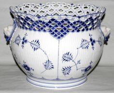 "ROYAL COPENHAGEN PORCELAIN 'OPEN LACE' JARDINIERE, CIRCA 1900, H 9"", DIA 11"":Having blue flower, full lace, gargoyle head mounts. #1/1046"