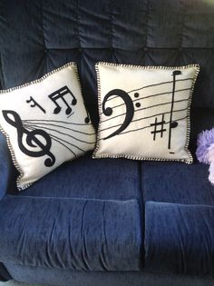 Cushions I made from an old wool blanket. The design is inspired by JS Bach's Prelude and Fugue in C Major ... My favourite piece.
