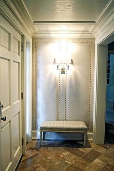 Entry Idea upholstery tacks.  would be great in small hallway to master