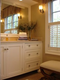 HGTV RMS-warm neutral colors, framed in mirror and matching shutters.
