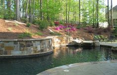 This is a great idera for a sloped backyard #pool #stone #patio #landscape #GA