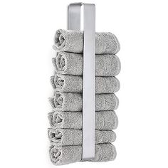 The Blomus NEXIO Guest Towel Holder can hold several bath towels in a compact space. It is a rectangular loop of stainless steel only 3 inches deep, and it mounts to the wall to contain rolled-up towels. (The exact number it can hold depends on towel size and thickness.)