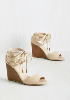 If you have a passion for both fashion and fantastic brews, lace up these wedges and live up the best of both worlds. Formed from super-soft faux leather, and flaunting cutouts at the ankles and a sweet cream and sugar hue, these sassy sandals are a coffee-lover's delight!
