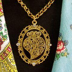 Portuguese lacy Heart of Viana gold tone metal filigree style medallion pendant with rhinestones necklace.$50.00#colarcoraçaodeviana#portuguesenecklace#madeinportugal#vianaheartpendant#lacyheartpendant#portuguesefiligreejewelry#portuguesevianaheart#goldfiligreeheart#helenaaleixo