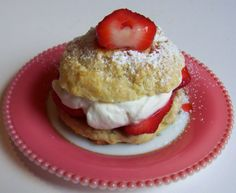 Strawberry Shortcake - This is a true Strawberry Shortcake, unlike so many made with a spongecake instead of a shortcake. Made in individual biscuits or baked in a long tart pan, it is served layered with fresh strawberries macerated in strawberry liquor and sugar, freshly whipped cream, more strawberries and cream and topped with another layer of shortcake. It is rich and simply delicious. - http://www.andros-kitchen.com/catering/