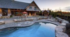 Concrete pool with armour stone and multiple outdoor living areas!
