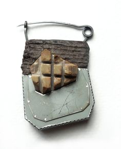 Tova Lund_brooch 2012.......Connie Fox: Contrast of texture, color and shape.
