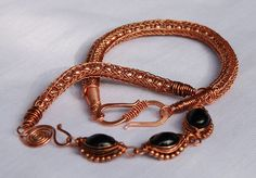 This are viking knit chains knitted around little copper beads. I used hair thin twisted copper wire for the chains.