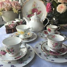 Glorious in the summer sun, pretty floral mismatched tea set, All but the cake serving plate are English china, this plate is Bavaria hand painted bright pink chrysanthemums with gold trim  This lovely tea set includes the following pieces: 1 white china 4 cup teapot, new item added as a supply to complete this set, manufacturer is an Italian china company 4 mismatched English teacups and saucers 4 matching English bone china plates by Royal Victoria, made in Englsand 1 English china creamer…