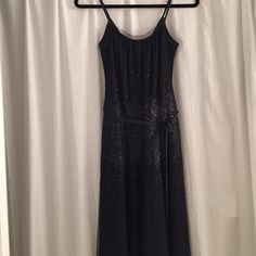 Vera Wang Lavender Label Black Sequin Tulle Dress Mesh tulle with sequin trim, grosgrain ribbon shoulder straps and waist tie, v-shaped back, tea length. Worn once. Vera Wang Dresses Midi