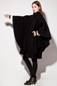 Vintage 70s Wool Cape Coat http://thriftedandmodern.com/vintage-70s-black-wool-cape