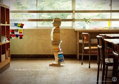 """Created earlier this year by Dentsu Tokyo for the Yokohama City Board of Education, the """"Books to build children"""" ad campaign hopes to recruit librarians to work in elementary school libraries. Yokohama, School Librarian, Library Displays, Inspirational Books, Advertising Campaign, Print Advertising, Print Ads, Ui Design, Graphic Design"""