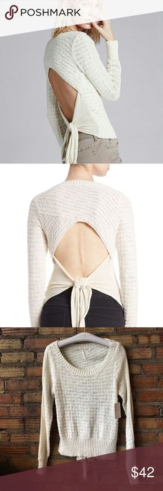 Free People Open Back stretch tie sweater Ballerina style! You'll be getting compliments left and right! Show off your assets! Gorgeous! Free People Sweaters