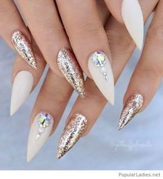 White stilettos nails with glitter