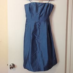 100% Silk Gorgeous Blue Strapless Dress, size 8. Great for a wedding or formal event! Ann Taylor 100% silk dress, royal blue, strapless (there are hooks for straps, but straps are not included). Size 8. Hidden side pockets!!! Knee length, dry clean. A very classic dress! Great condition! Ann Taylor Dresses Strapless
