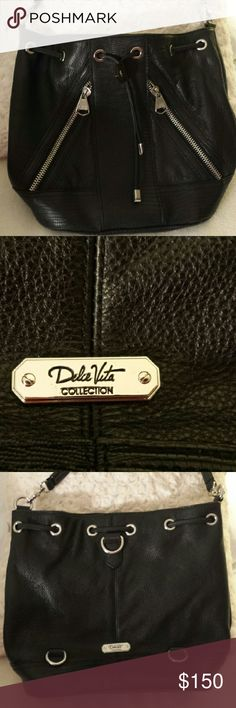 Dolce Vita Collection Black Leather Tote New without tags  - This tote isc100% soft leather with diagonal zippered pockets with metal puller hardware.  This is a rich classic style bag. 3 interior pockets Dolce Vita Bags