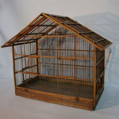 Vintage antique bird cage. id add fake flowers and my pretty finches, make it gorgeous :)