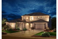 Stone accents, tile roof and a side entry 3rd car garage create a rich desert look. Shea Homes in Phoenix