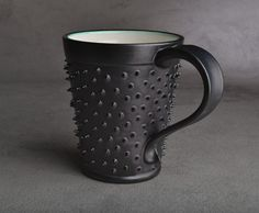Spiky Mug: Made To Order Black and White Dangerously Spiky Mug by Symmetrical Pottery. $20.00, via Etsy.