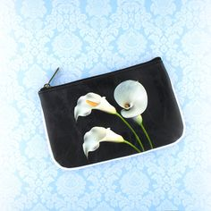 Flower collection by Malvi, made with vegan and Eco-friendly materials. This calla lily small pouch has matching cross body bag, wristlet wallet and medium pouch. Wholesale available at www.mlavi.com. Shop now at https://mlavi.ca/search?page=1&q=flower&type=product #flower #vegan #fashion #accessories #gift #wholesale #wallet #bag #purse #pouch #shopping