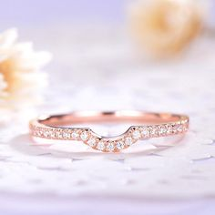 This is a half eternity U shape wedding band rose gold plated. The stones are VVS man made cz diamond. can be stacked or matching. The stones can be replace with other gemstones.For example,if you dont like the CZ accent,you can ask me replace it with