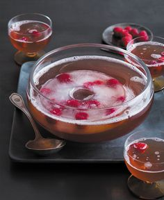 GRAND PUNCH BOWL 2 cups Grand Marnier® spirit 2 chilled (750 ml) bottles dry Prosecco ½ cup black raspberry liqueur 2 cups unsweetened pineapple juice 1 quart chilled ginger ale 2 cups fresh raspberries In a large bowl, combine Grand Marnier®, black raspberry liqueur, pineapple juice and chill covered for at least 4 hours or overnight. Top with ginger ale and Prosecco. Garnish punch with raspberries and serve. Serves 20.