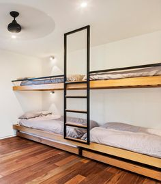 Interior Design Ideas For Sleeping Six People In A Room // These bunk beds, in a home designed by ARKit, both have trundle beds that roll out on the floor, so six people could sleep in this room.