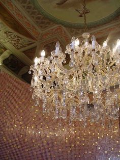 Ceiling and chandelier at a old Venice building.
