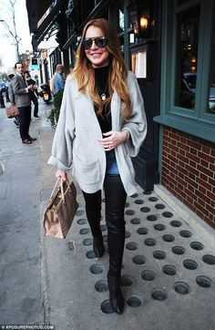 Lindsay Lohan wearing Azzedine Alaia Eyelet Ankle Boots, Prada Saffiano Luxe Leather Tote, R13 Skinny Leather Chap Jeans and Wildfox Essentials Slouch Cardigan in Smokey Bear
