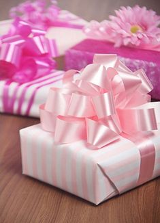 Gift wrapped in pink gift wrapping and pink pom pom bow