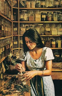 A curandera at work preparing the herbs that she will use in her healing practice, either as medicine or a ritual aid.