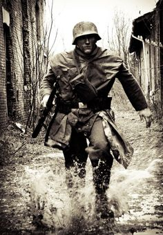 German soldier running during city fighting