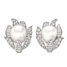 David Webb South Sea Pearl Diamond Earclips | From a unique collection of vintage clip-on earrings at http://www.1stdibs.com/jewelry/earrings/clip-on-earrings/