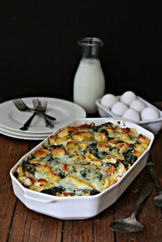 Cheesy Spinach Strata. Perfect make ahead breakfast for lazy fall weekends and for when you've got company in town!