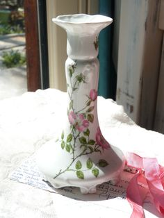 Vintage French Limoges Porcelain Candle Holder - Shabby chic - Roses Pattern - Hand Painted - Limoges France - Home Decor - Autumn Finds  * great vintage condition, no chips  * 16 cm or 6.3 tall * 9 cm or 3.5 base diameter  * marked on the bottom: N.B.D, Limoges, Limoges France, Peint à la main  A lovely vintage addition to add a little french charm, color and history to your home!  Thanks for visiting my shop: http://www.lunapurpurie.etsy.com