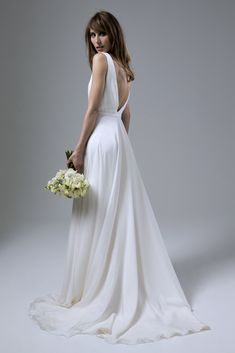 Wedding dress by Halfpenny London | Bridal Fashion by Kate Halfpenny | Wrap over, floaty chiffon dress, plunging V back, narrow belt, feather, cap sleeves. Daisy Chiffon Dress With Narrow Belt.