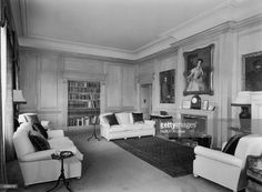 The Duke of Edinburgh's sitting room in Clarence House, London, 1949. The house was built in 1825-27 by John Nash for the Duke of Clarence, later King William IV. The panelling is of white Canadian maplewood and the portraits are of the prince's parents, Prince and Princess Andrew of Greece, and his grandfather, the 1st Marquess of Milford Haven, by Laszlo.